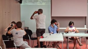 Participants trying out the BrainCom Virtual Reality Experience at the 2021 Biennal Ciutat i Ciencia in Barcelona, Spain